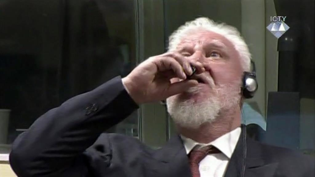 Defiant to the end: Slobodan Praljak downs the liquid in court PIC: AP