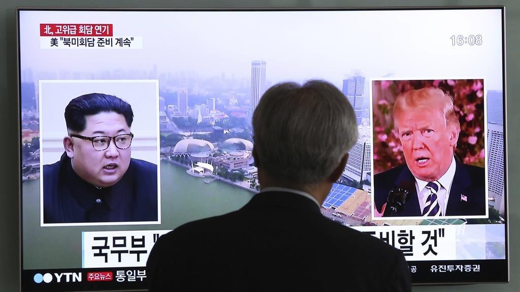 Talking heads: A South Korean TV report on Kim Jong-un and Donald Trump PIC: AP