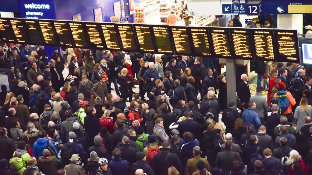 Waiting: A crowd at London's Waterloo station PIC: REX