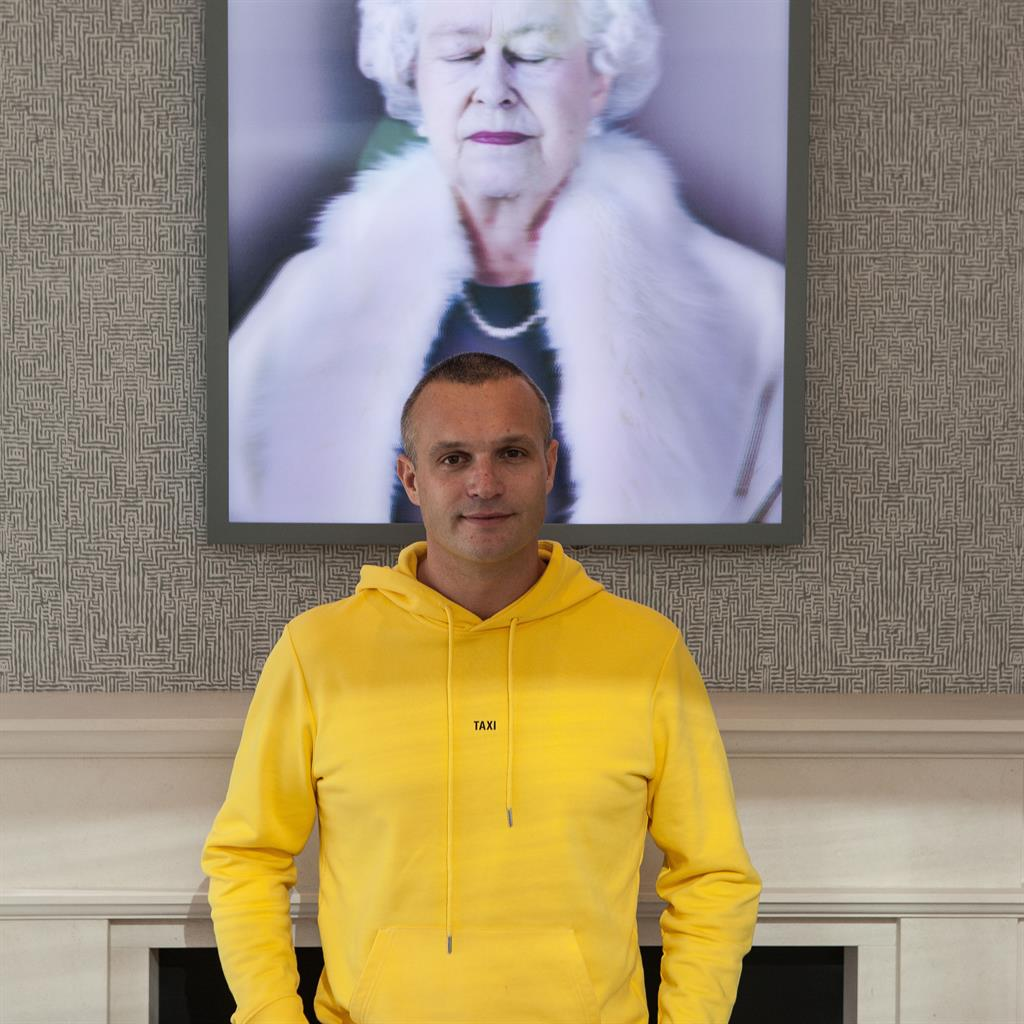 Unabashed royalist: Jamie with a portrait of the Queen