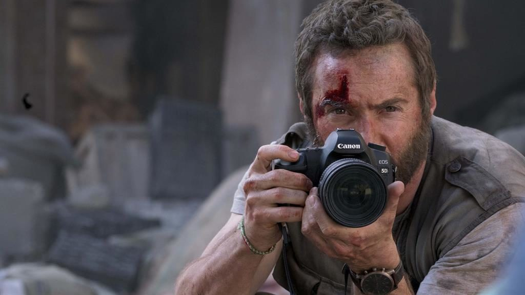 Focus on truth: Alessandro Nivola plays photographer Lee Berger, and (below) Katie Leung (as Liuli) and Jay Yu (young Zhang Lin) in Chimerica PICTURES: PLAYGROUND/CHANNEL 4