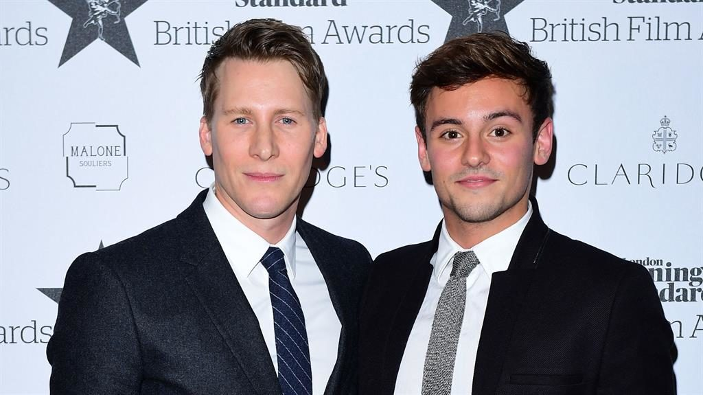 Tweet row: Dustin Lance Black (left) with husband Tom Daley PICTURE: PA