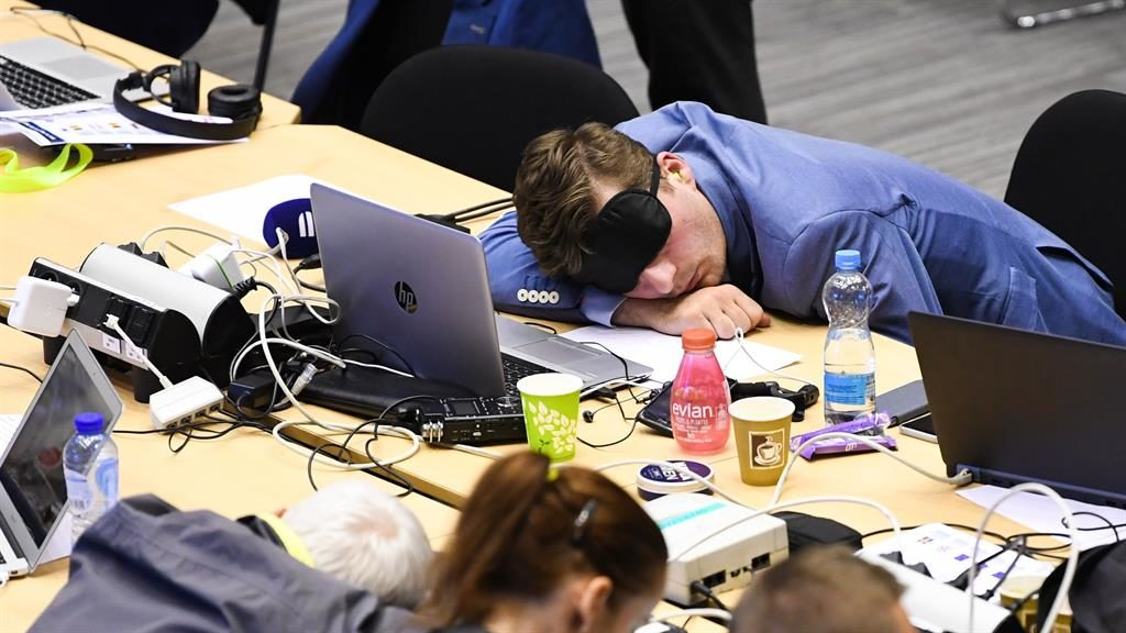 Lights out: Exhausted newsman in sleep mask dozes at his post PICTURES: ISOPIX/REX
