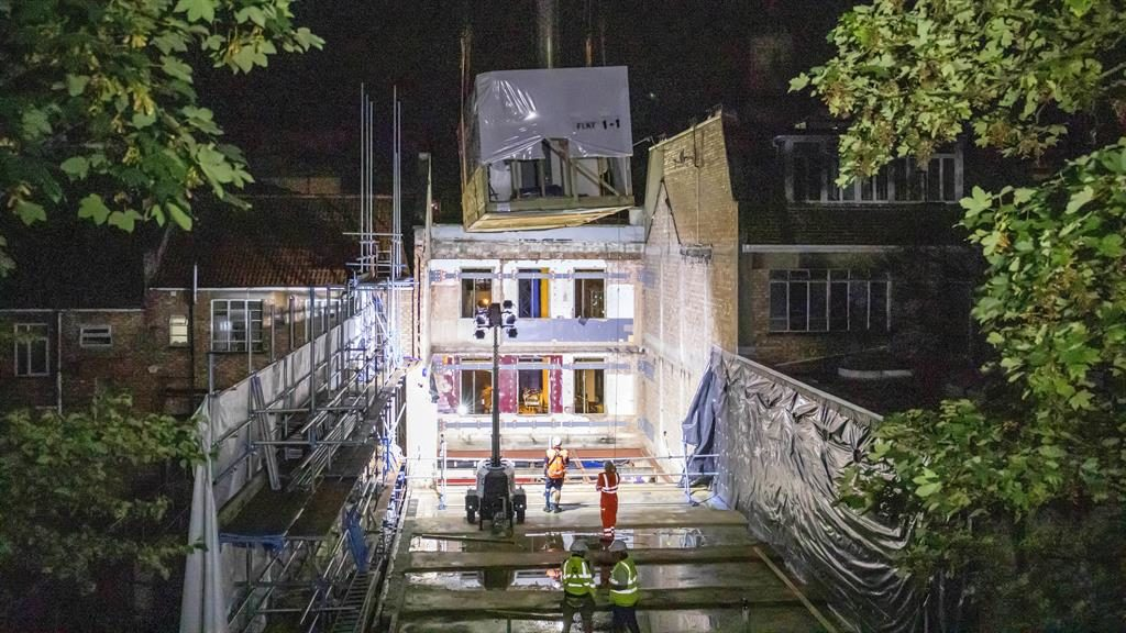 Rooms for a few: The homes are lowered into place inside the former nightclub PICTURE: SWNS