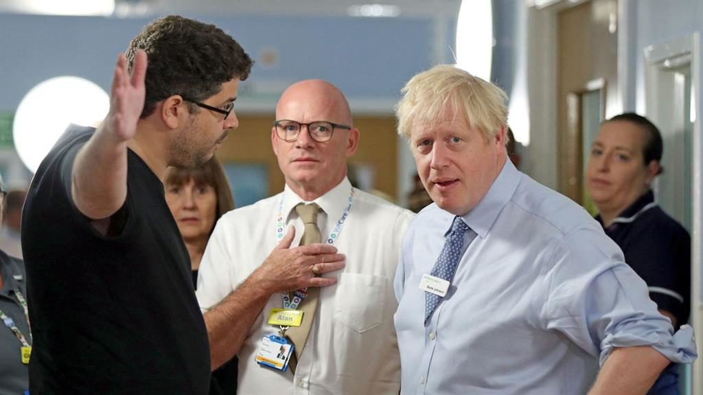Confronted: Omar Salem speaks to Boris Johnson in Whipps Cross hospital PICTURE: GETTY