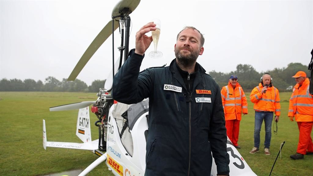 Bubbling with excitement: James Ketchell celebrates after his record-breaking round-the-world flight