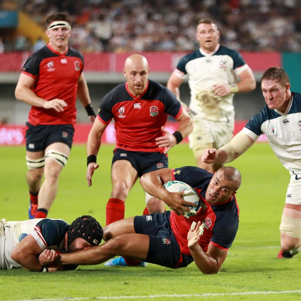Holding on: Jonathan Joseph of England is tackled short of the try line during the game between England and US PICTURE: GETTY