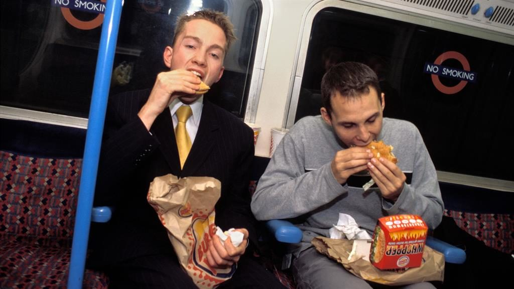 Relish: Eating burgers on London Tube PICTURE: ALAMY