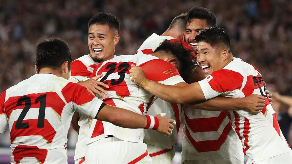Happy hosts: Japan players celebrate victory over Scotland PICTURE: GETTY