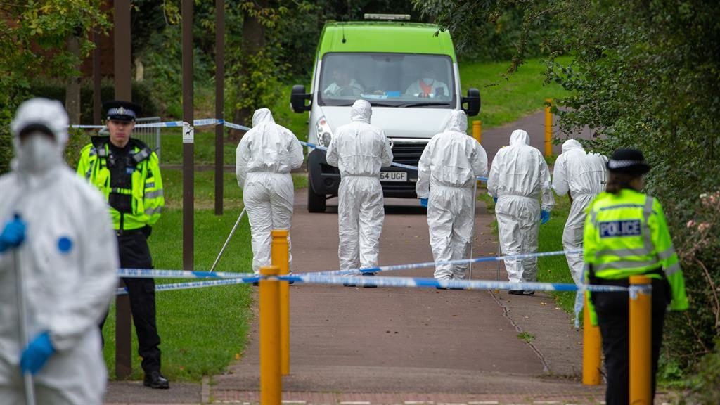 Investigation: Forensic teams carry out a search near double murder scene in Milton Keynes PICTURE: GEOFF ROBINSON PHOTOGRAPHY