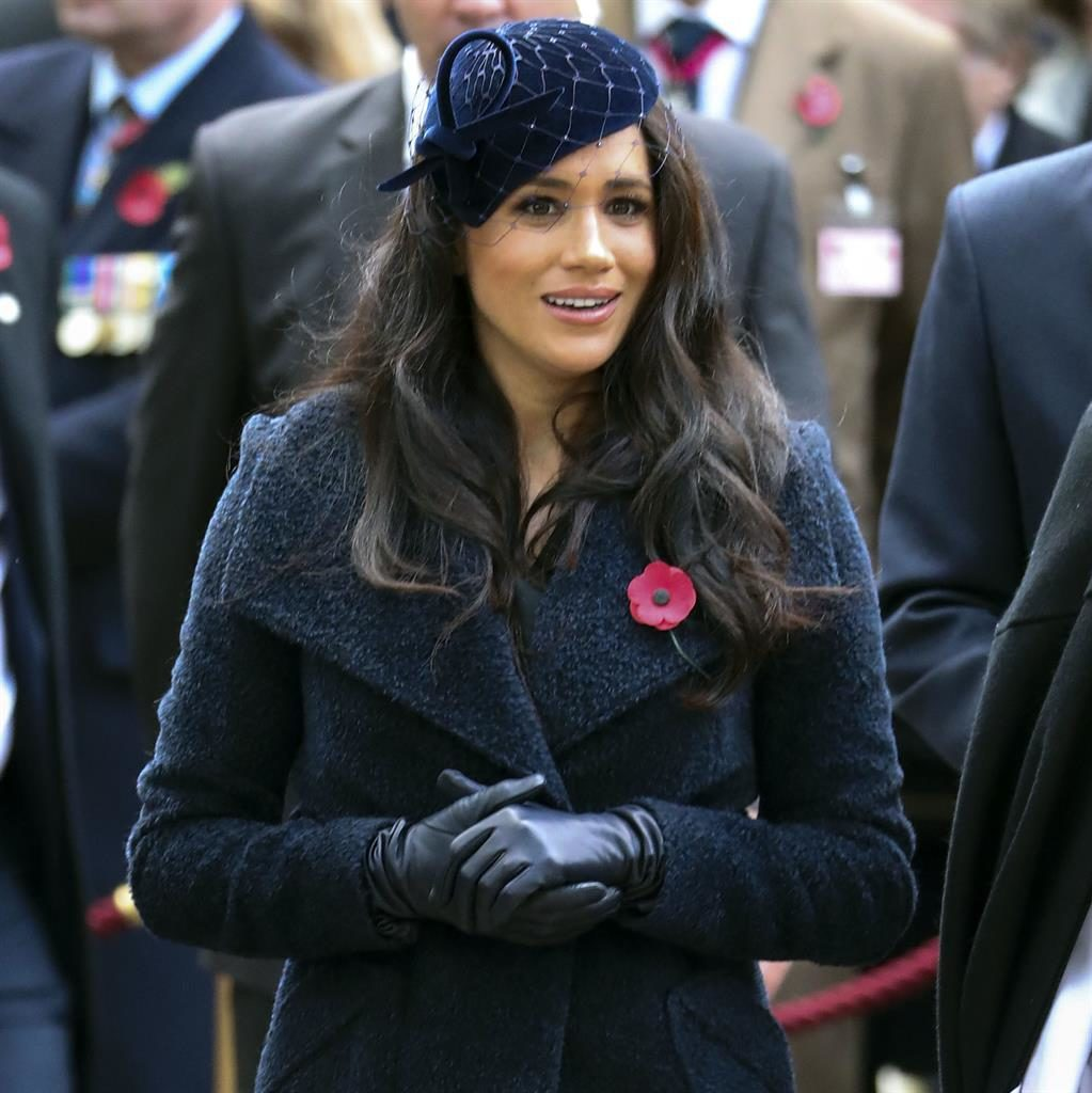 Salute to the navy: Meghan yesterday in her navy blue coat and matching velvet hat PICTURES: PA