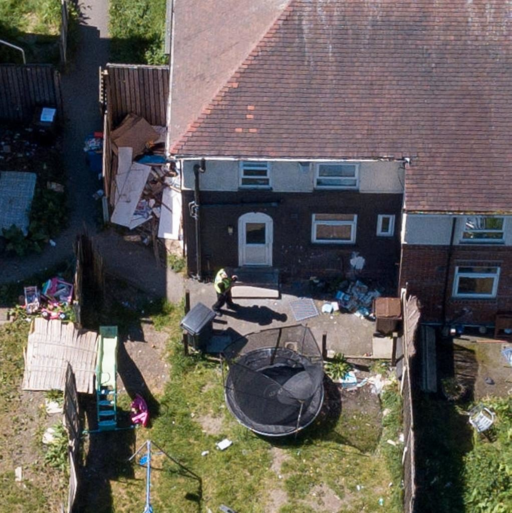 Hid a dark secret: Barrass's home in the Shiregreen area of Sheffield PICTURES: SWNS/PA