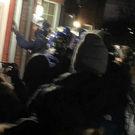 Blitz: Officers entering an address during the raids PICTURE: SWNS