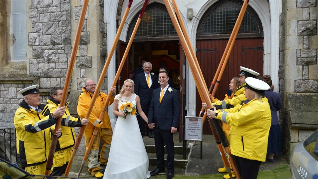 All at sea: Izzy and Neil Daubney receive a special guard of honour PICS: SWNS