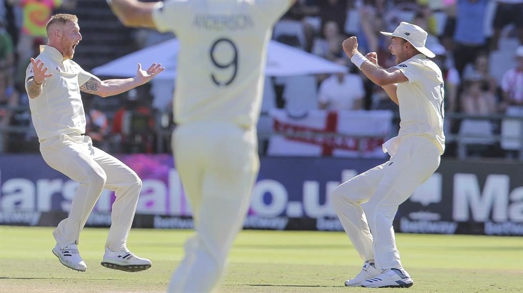 On the way to a win: Ben Stokes (left) and the England team celebrate the wicket of Anrich Nortje PICTURE: AP