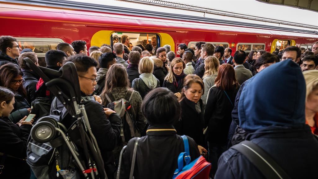 Dissatisfied: Rail passengers board a train in Wimbledon, south-west London