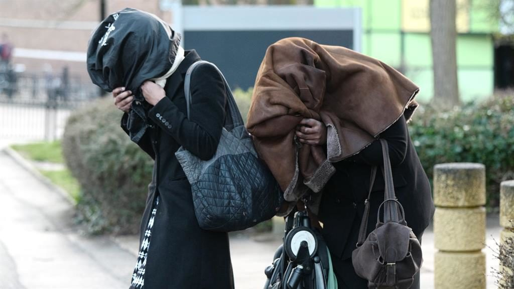 Charges: Mitaiare and Roberts hide their faces leaving court yesterday PICTURE: W8MEDIA