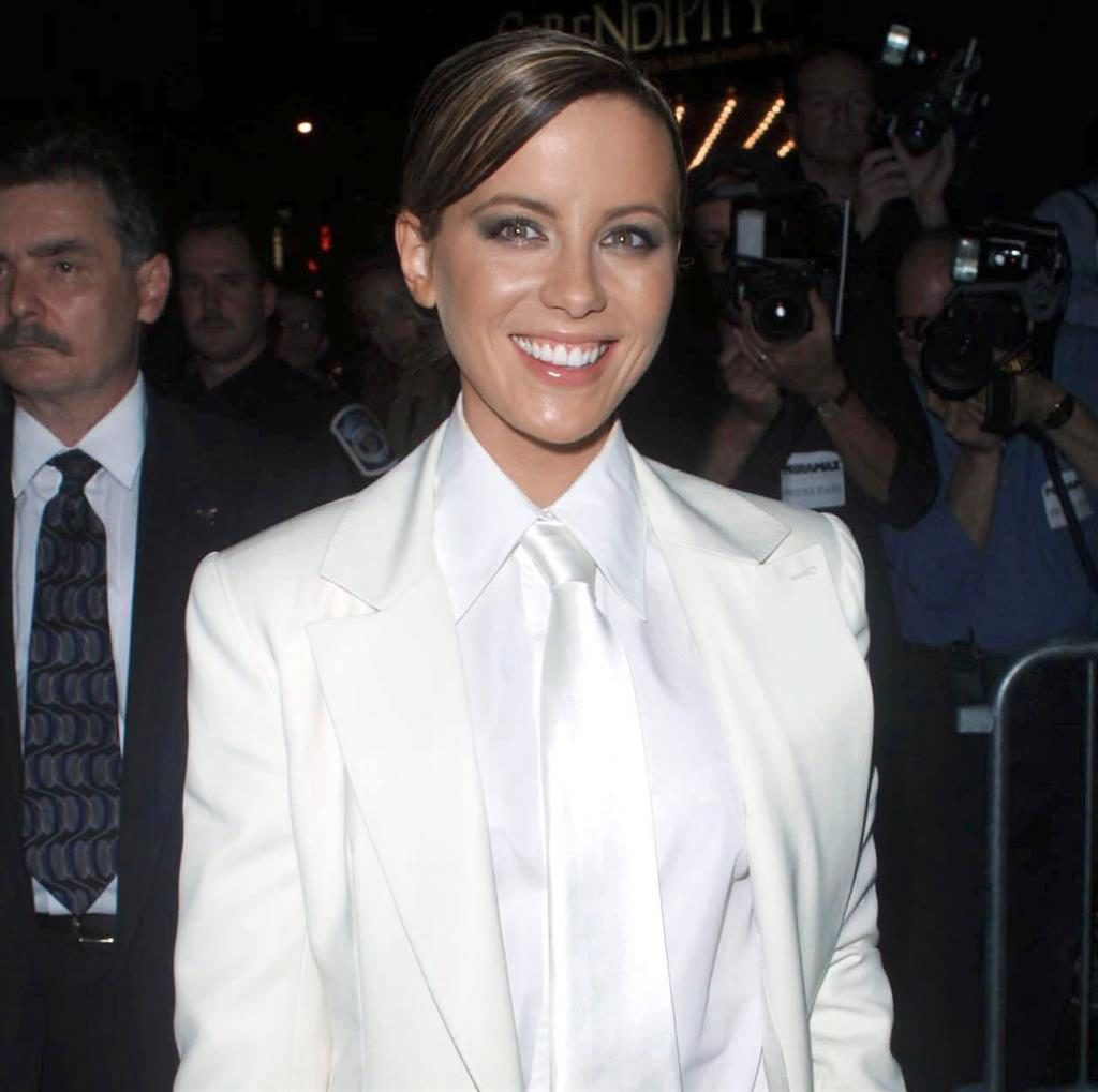 Not Serendipitous: Weinstein did not approve of Kate's red carpet look at a 2001 premiere; and, below, a heated conversation between the pair in 2004 PICTURES: REX