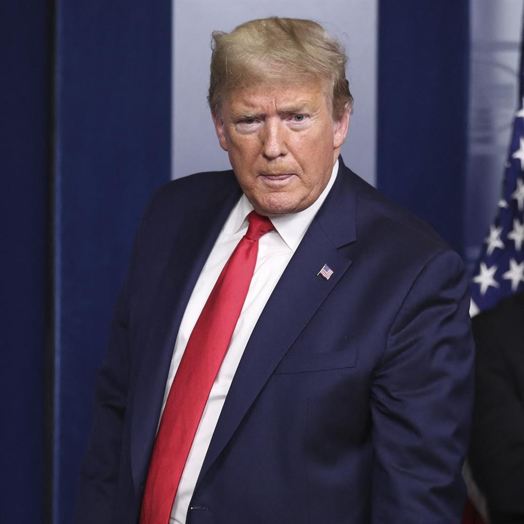 Running out of time: Donald Trump was accused of giving economy priority over health PICTURE: ABACAPRESS.COM