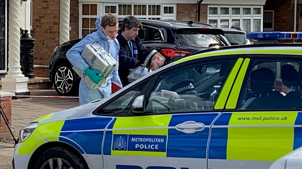Evidence: Police search the property in Upminster, Essex, after the incident on May 1