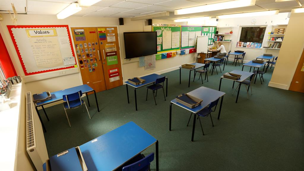 Waiting game: Tables spaced out in a classroom as Watlington Primary School in Oxfordshire prepares to reopen to children on June 1 PICTURE: REUTERS