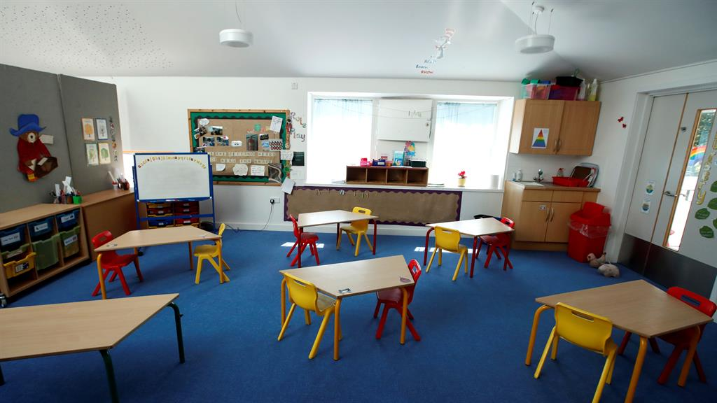 Special measures: Desks at Heath Mount Prep School in Hertfordshire and (below) a hand sanitising station at the school