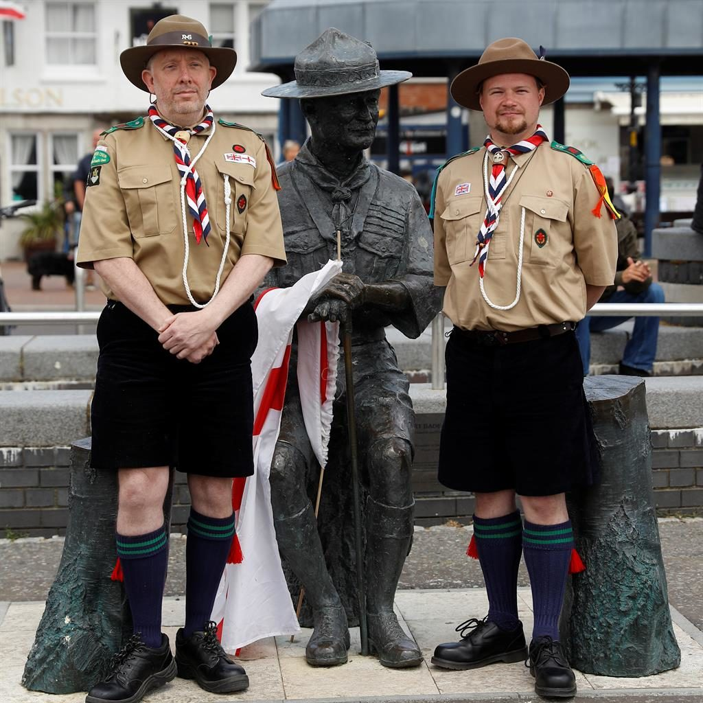 Standing by their man: Scouts Chris Arthur and Matthew Trott at the Baden-Powell statue in Poole, Dorset PICTURE: REUTERS