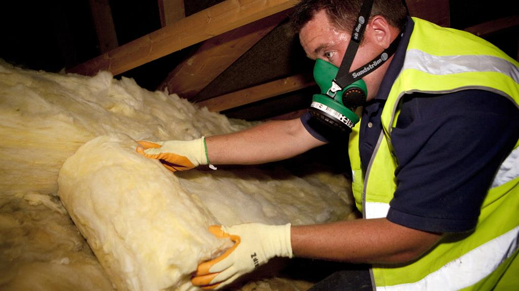Home improvement: Loft insulation being installed, but critics say new fund won't insulate us against economic and climate crises PICTURE: REX/SHUTTERSTOCK