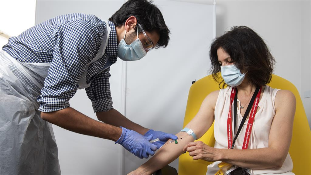 A slight scratch: A doctor takes blood samples for use in coronavirus vaccine trials at Oxford University PICTURES: AP