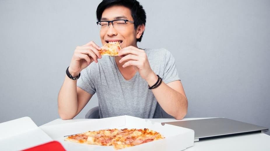 Nice slice: Participants were able to eat almost 3,000 calories worth of pizza despite declaring themselves full at 1,500 PICTURE: DEAN DROBOT/SHUTTERSTOCK