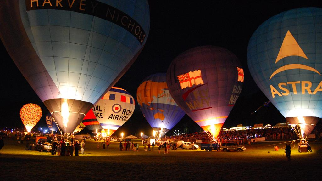 Glow on: Bristol's flagship balloon fiesta will take the form of a 'virtual nightglow this year'. Below: Ed Harcourt, Jimmy Carr and Sara Pascoe