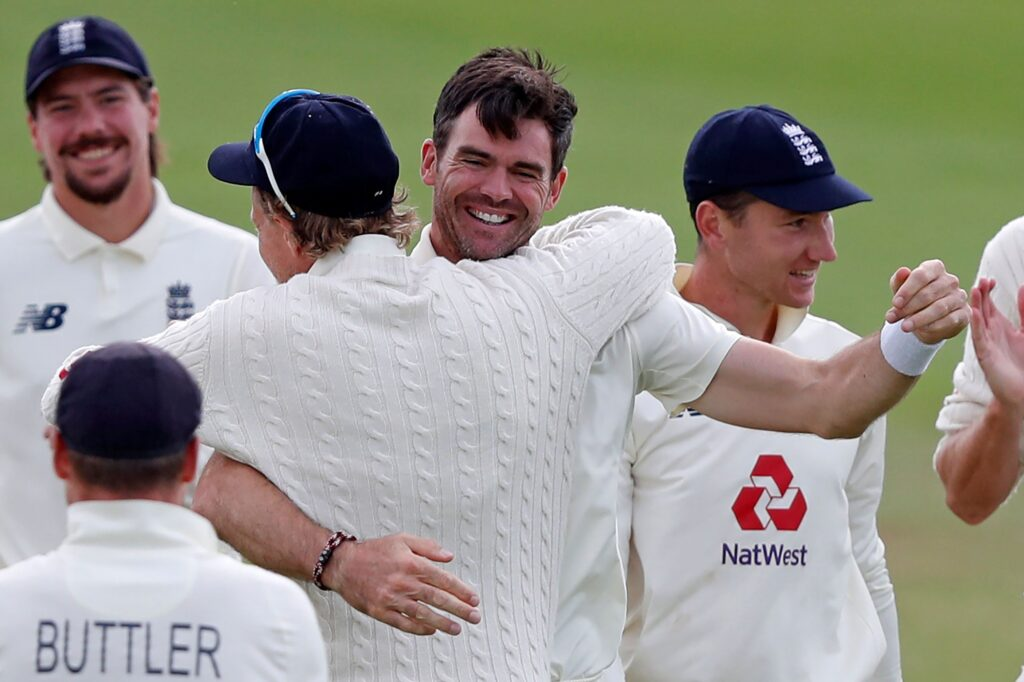 Howzat! James Anderson (centre) embraces Joe Root who takes the catch of Pakistan's Azhar Ali to get Anderson his 600th Test wicket PICTURE: GETTY