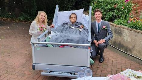 Tender moment: Luke and Abi arranged their wedding at hospice so his nan Vera Robertson could witness big day