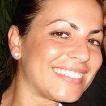 Grin reaper: Cecilia Marogna was held in Milan on an international arrest warrant on Tuesday