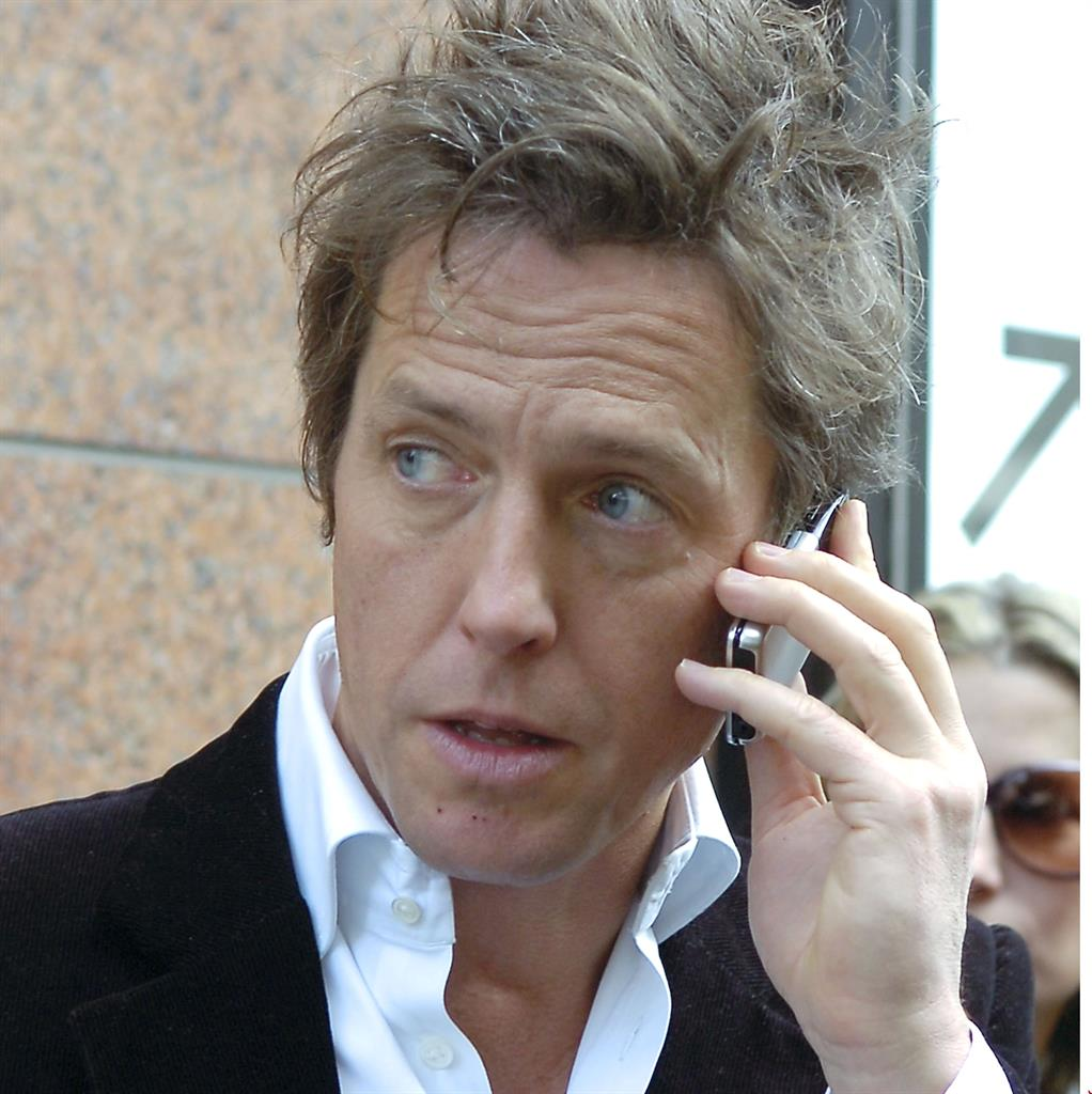 Toxic telephone: Hugh on his mobile back in 2007; and, below, while filming his latest show The Undoing PICTURES REX/AP
