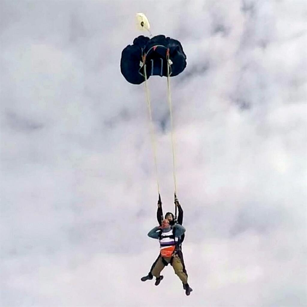 Left hanging: Dave Pagett and his instructor float down with a back-up parachute PICTURES: SWNS