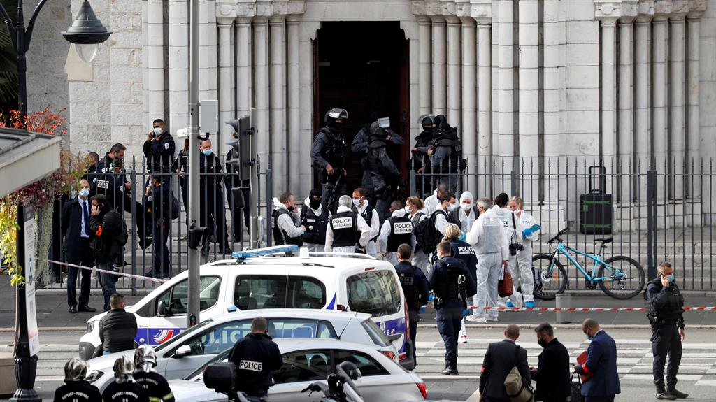 Terror alert: Security forces guard the area after a knife attack was reported at the Notre Dame church in Nice, France PICTURE: REUTERS