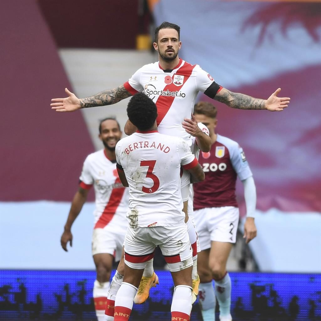 Lift-off: Ings takes the congratulations from Ryan Bertrand after getting Saints' fourth at Villa Park