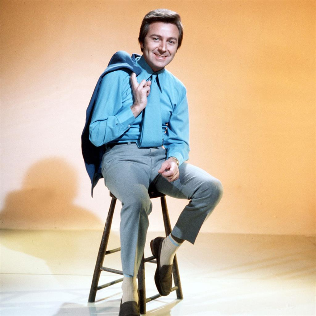 National hero': Chat show host and entertainer Des O'Connor, pictured fronting his popular Saturday night television variety show in 1970 PICTURE: ITV/REX