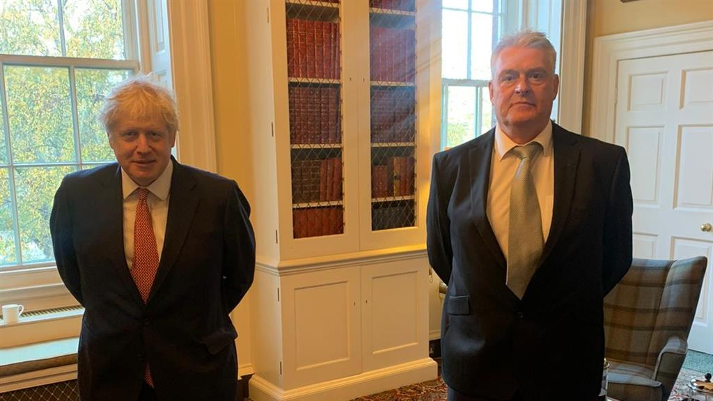 Close contact: Mr Johnson with MP Lee Anderson who tested postive for Covid-19