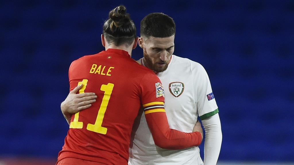 Brief embrace: Bale hugging Doherty and (below) in training yesterday PICTURES: REUTERS/REX