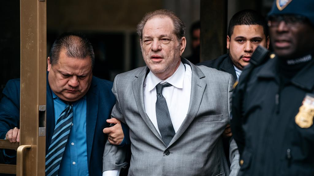'Unwell': Harvey Weinstein (centre) leaving court in New York PICTURE: GETTY