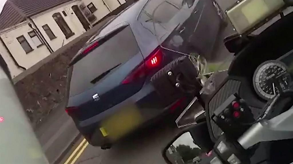 Caught on camera: PC Lovering approaches Seat Leon before Callum Fellows (pictured bottom) rams him and drives off PICTURES: SWNS