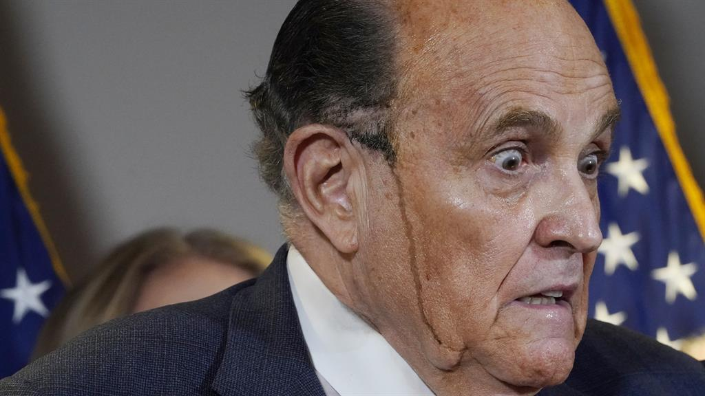 To dye for? Rudy Giuliani at the press conference in Republican headquarters, Washington DC PICTURE: AP
