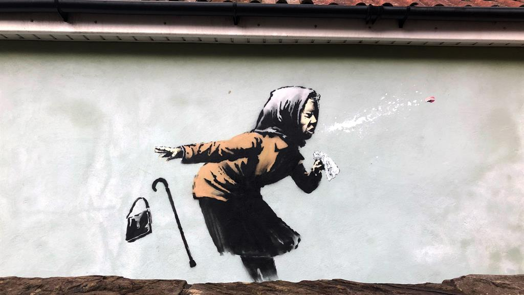 Banksy confirms he is behind sneezing woman artwork on Bristol house