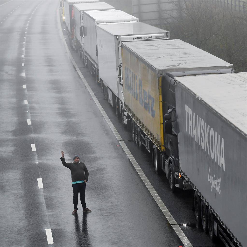 Empty gesture: Driver's hand signal beside parked trucks on M20 outside Dover PICTURE: REUTERS