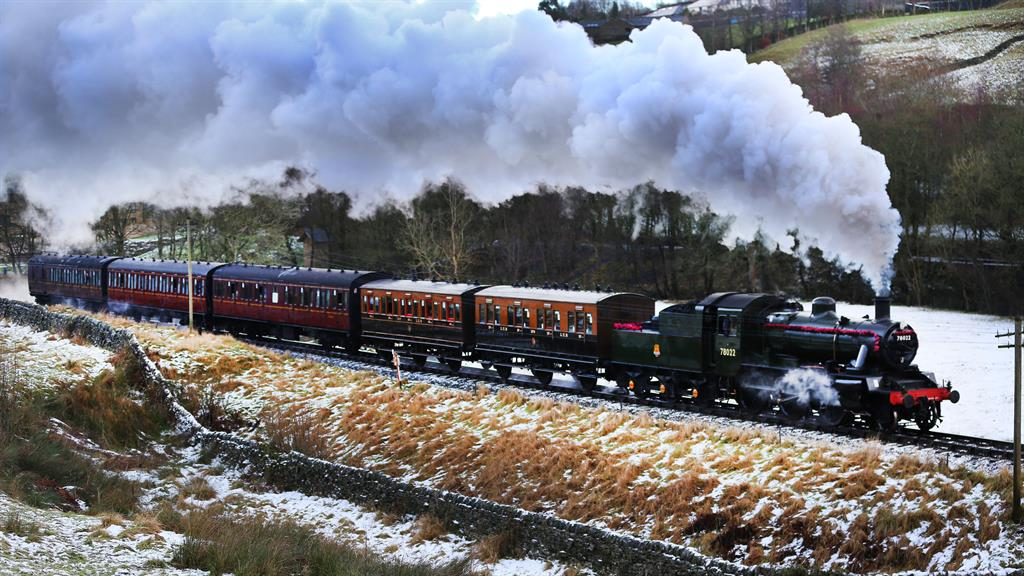 Polar express: A steam train passes through snow-covered hills in Haworth, West Yorkshire, yesterday  PICTURE: GUZELIAN