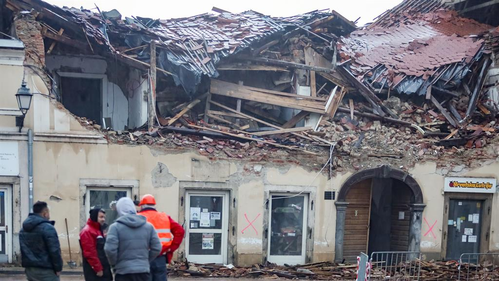 Devastation: Quake-hit residents survey wrecked homes in Petrinja PICTURE: GORAN JAKUS/REX