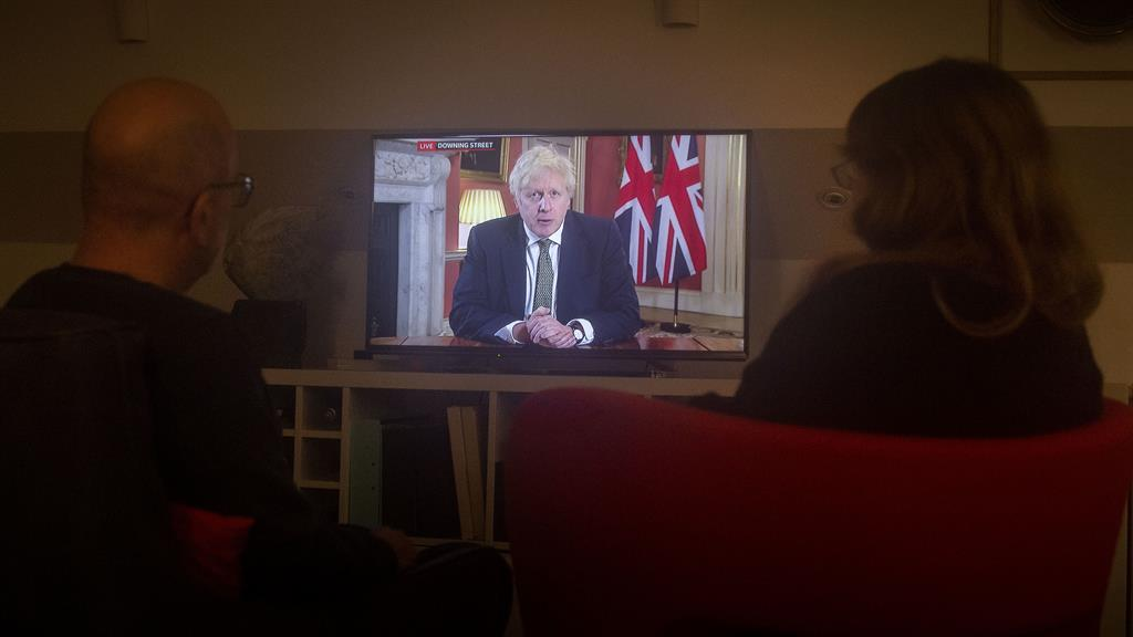 Home again, naturally: Boris Johnson makes a televised address to the nation from Downing Street PICTURE: PA