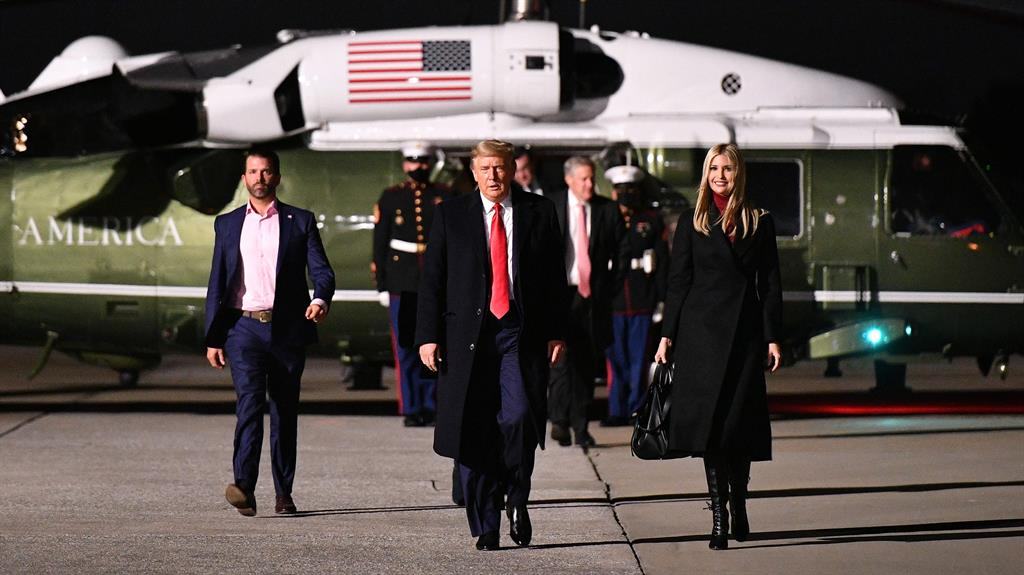 Top Trumps: Donald Trump, daughter Ivanka and son Donald Jnr at airfield on flying visit to Georgia PICTURE: GETTY